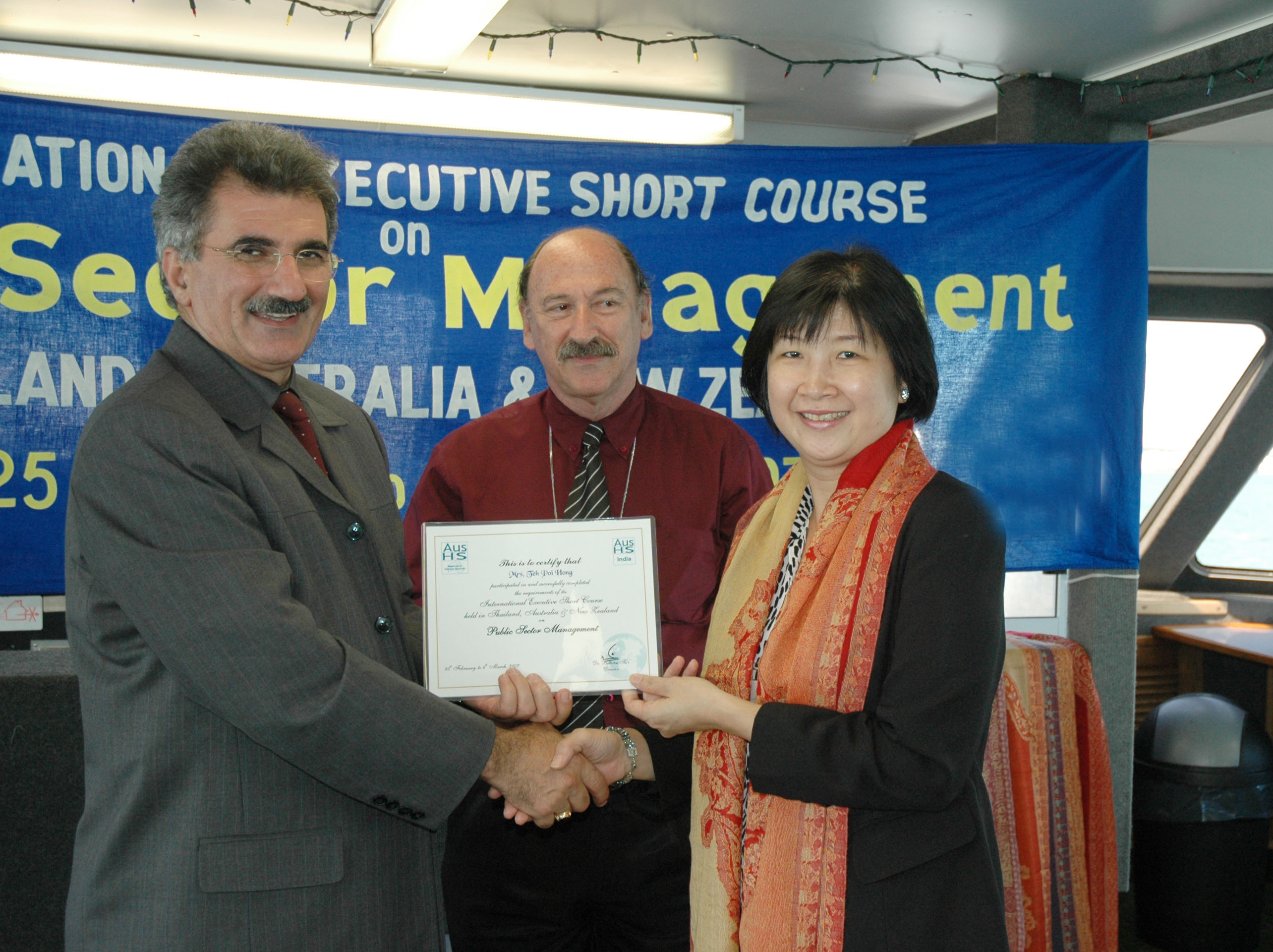 Presentation of Course Certificate to a distinguished participant of a CBN international training and study tour workshop held in New Zealand; short course on Good Governance series.