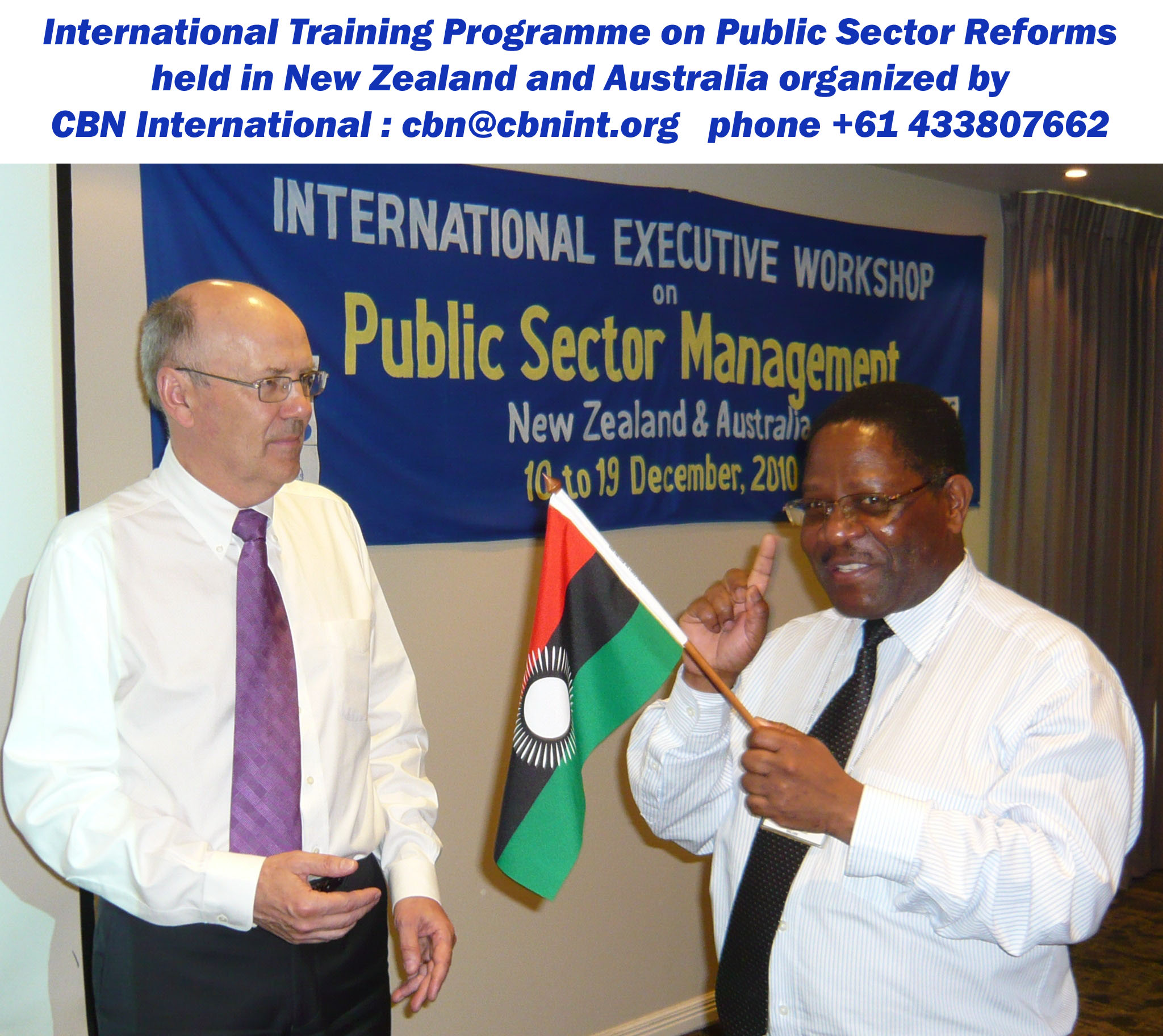 Mr. Necton D. Mhura, Dy. Chief Secretary, Malawi presenting a memento to Hon. David Caygill, former Minister of Finance New Zealand during a CBN international training and study tour programme held in Auckland; short course on Good Governance series.