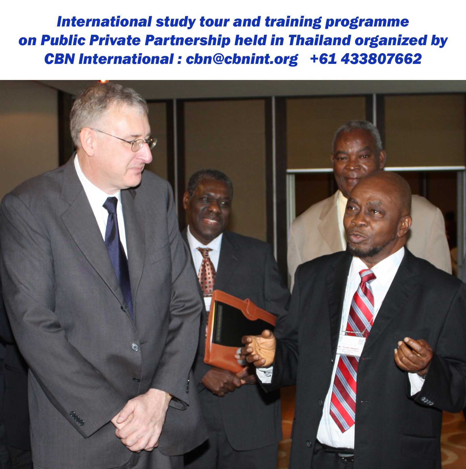 Dr. Tunde Akogun, Leader of the House, National Assembly of Nigeria in conversation with CBN resource person Mr. Trevor Bull during a CBN international training and study tour workshop held in Bangkok; short course on Good Governance series.