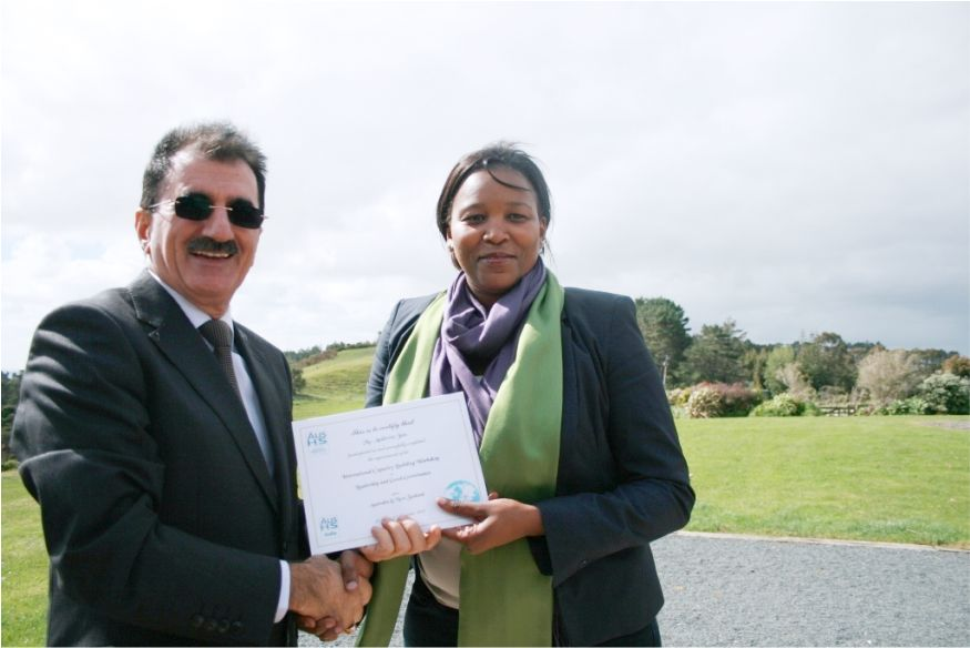 Presentation of course certificate to a distinguished participant during a CBN international training and study tour workshop held in Auckland, New Zealand; short course on Good Governance series.
